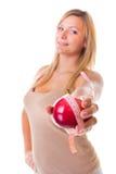 Vrouw plus grootte groot meisje met appel die het verlies van het bandgewicht meten. Geïsoleerd. Royalty-vrije Stock Afbeeldingen