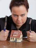 Vrouw protectong haar huis Royalty-vrije Stock Afbeeldingen