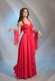 Vrouw in rode avondjurk Stock Fotografie