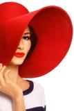 Vrouw in rode hoed Stock Fotografie