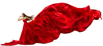 Vrouw in rode kleding met vliegende golvende stof Stock Afbeeldingen