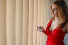 Vrouw in rood stock foto