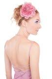 Vrouw in roze kleding en met terug haar stock foto's