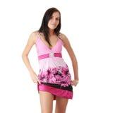 Vrouw in roze kleding met orthodontisch toestel Royalty-vrije Stock Afbeeldingen