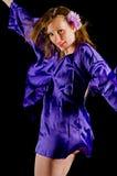 Vrouw in satan robe Stock Fotografie