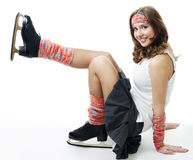 Vrouw in schaatsenglimlach royalty-vrije stock afbeeldingen