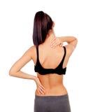 Vrouw in sportkleren met rugpijn Stock Afbeeldingen