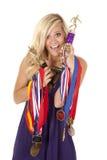 Vrouw trots van trofeeën stock foto's