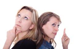 Vrouw twee denkt Stock Afbeeldingen