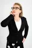Vrouw in twijfeluitdrukking Stock Foto's