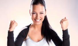 Vrouw van de kampioen met vuisten klemde in overwinning dicht royalty-vrije stock afbeelding