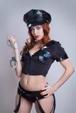 Vrouw van de schoonheids de sexy politie Stock Afbeelding