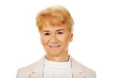 Vrouw van het glimlach de elegante hogere blonde Stock Afbeeldingen