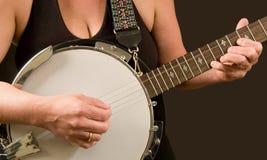Vrouw vinger-plukt de banjo Royalty-vrije Stock Foto