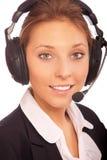 Vrouw -vrouw-distpetcher met oortelefoons Stock Foto