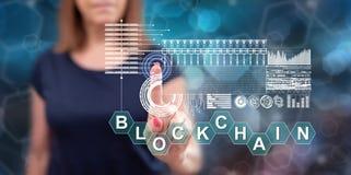 Vrouw wat betreft een blockchainconcept royalty-vrije stock foto's