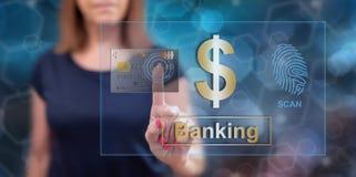 Vrouw wat betreft een concept van de bankwezenveiligheid stock fotografie
