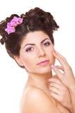 Vrouw wat betreft haar gezicht Royalty-vrije Stock Afbeelding