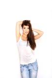 vrouw in wit vest en jeans op witte achtergrond Royalty-vrije Stock Afbeeldingen