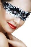 Vrouw in zilveren masker Stock Foto