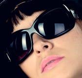 Vrouw in zonnebril Stock Foto