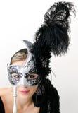 Vrouw in zwart masker Stock Afbeelding