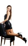 Vrouw in zwarte glanzende kleding royalty-vrije stock fotografie