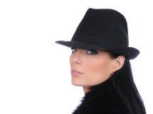 Vrouw in zwarte hoed Royalty-vrije Stock Foto's