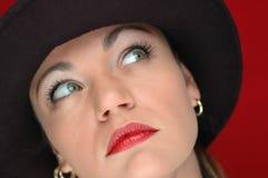 Vrouw in zwarte hoed 3 Stock Foto's