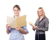 Vrouwelijk commercieel team dat op wit wordt geïsoleerdr Royalty-vrije Stock Foto's