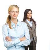 Vrouwelijk commercieel team dat op wit wordt geïsoleerds Stock Afbeeldingen
