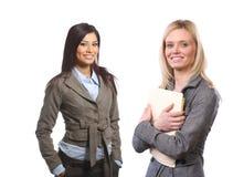 Vrouwelijk commercieel team dat op wit wordt geïsoleerds Royalty-vrije Stock Foto's