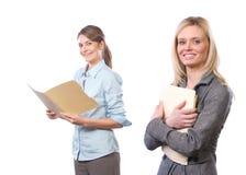 Vrouwelijk commercieel team dat op wit wordt geïsoleerds Stock Foto