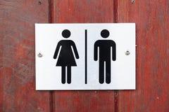 Vrouwelijk en mannelijk toiletteken stock afbeelding