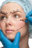 Vrouwelijk gezicht vóór plastische chirurgieverrichting Royalty-vrije Stock Foto
