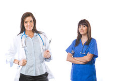 Vrouwelijk medisch team dat op wit wordt geïsoleerd stock afbeeldingen