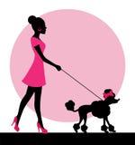 Vrouwelijk silhouet met een hond stock illustratie