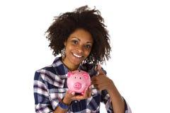 Vrouwelijke afro Amerikaan met spaarvarken Royalty-vrije Stock Afbeelding