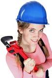 Vrouwelijke arbeider die een moersleutel houdt. Stock Foto's