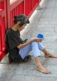Vrouwelijke Aziatische Begger. Stock Afbeelding