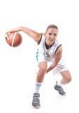 Vrouwelijke basketbalspeler in actie Royalty-vrije Stock Foto