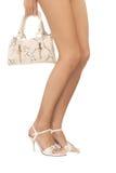 Vrouwelijke Benen en witte zak Stock Afbeelding