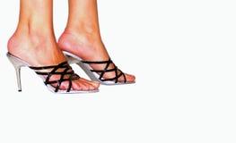 Vrouwelijke benen in hoge hielen Stock Fotografie