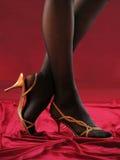 Vrouwelijke benen in leeglopers. Stock Afbeelding