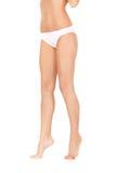 Vrouwelijke benen in witte bikinikousen stock foto's