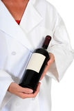 Vrouwelijke Chef-kok met Fles Wijn stock afbeelding