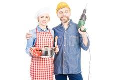 Vrouwelijke Cook With Husband royalty-vrije stock fotografie