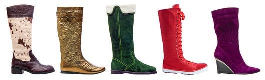 Vrouwelijke de winter hoge laarzen met weg Stock Fotografie