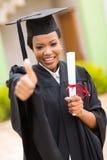 Vrouwelijke gediplomeerde duim omhoog stock afbeelding