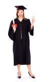 Vrouwelijke gediplomeerde met omhoog duim royalty-vrije stock afbeelding